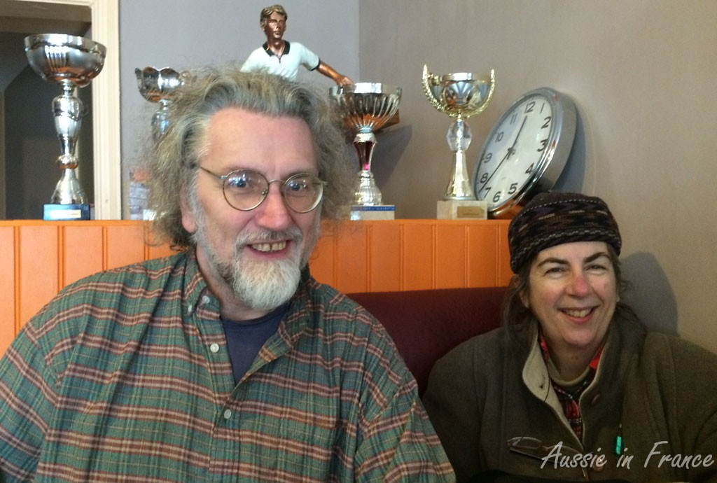 Simon and Susan in front of the soccer trophies