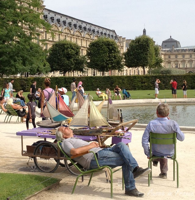 The photo was taken in the Tuileries Gardens. The same man has been renting boats to children here for many years.