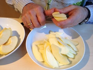 Cutting up apple into thin slices