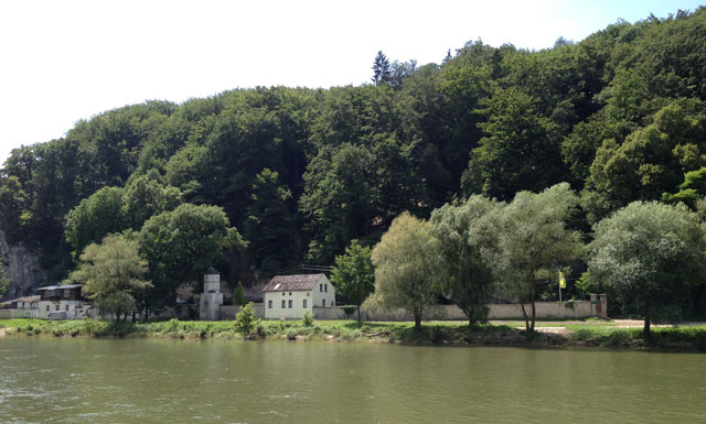 A smaller monastery on the banks of the Danube with a troglodyte church