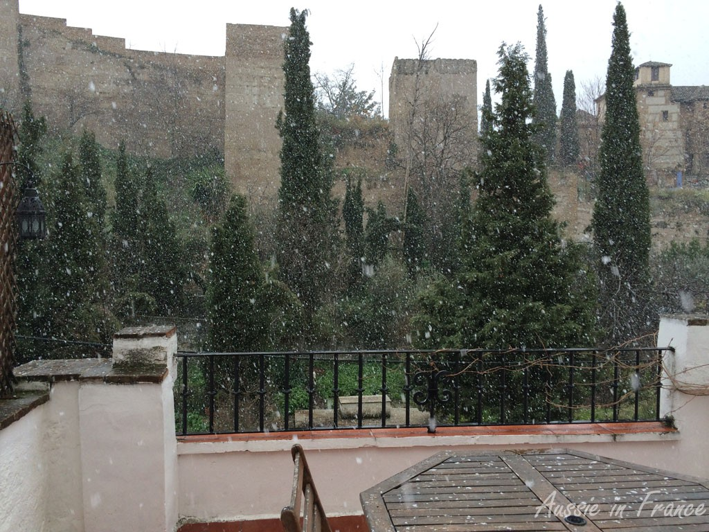 Snow falling on our terrace