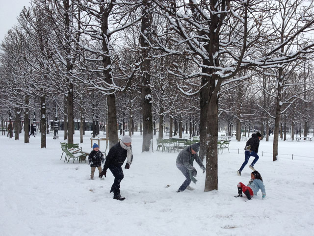 Family having a snow fight in the Tuileries Gardens