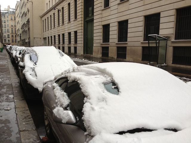Snow on the cars in our street