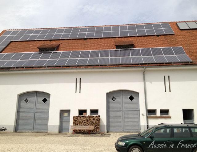 Solar panels on a traditioanl barn in a village