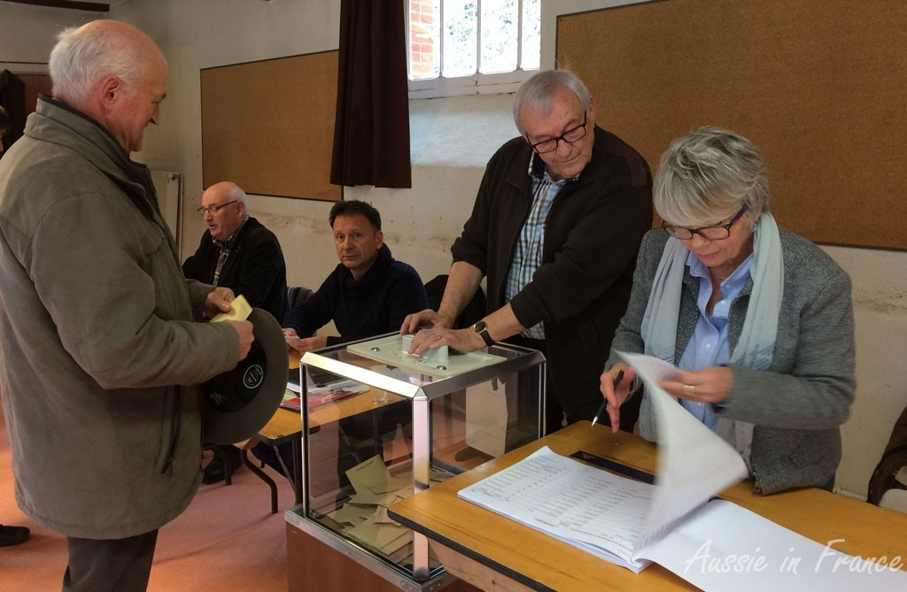 Jean Michel about to but his ballot in the urn