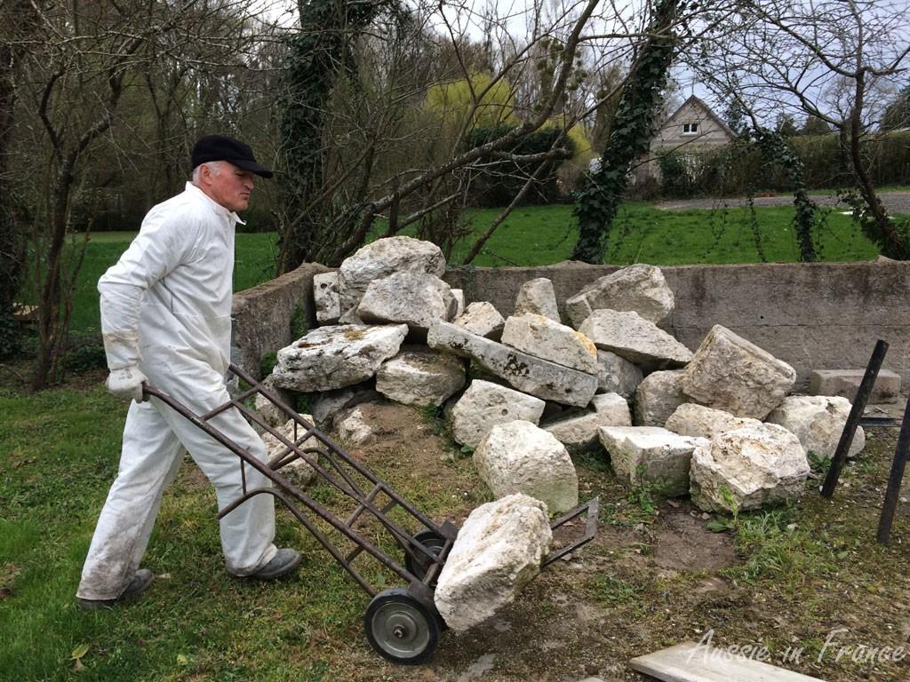 Jean Michel wheeling the stones on the trolley