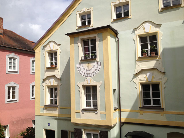 Sun dial on a typical painted façade