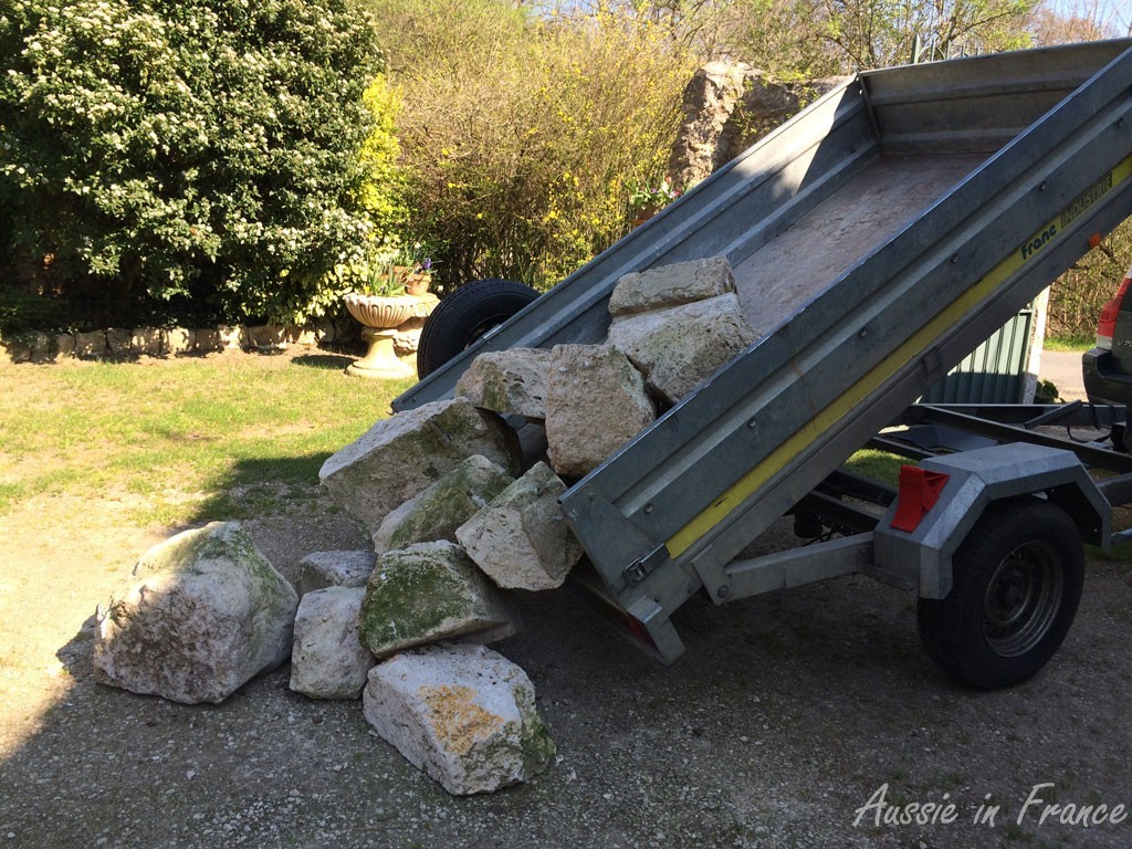 Tipping the stones from the trailer onto the ground at home