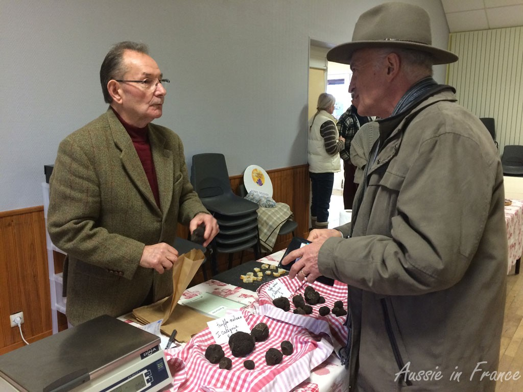 Jean Michel buying our two truffles