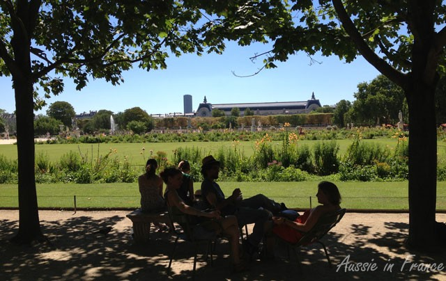 Under the shady trees in the Tuileries with Orsay Museum in the distance