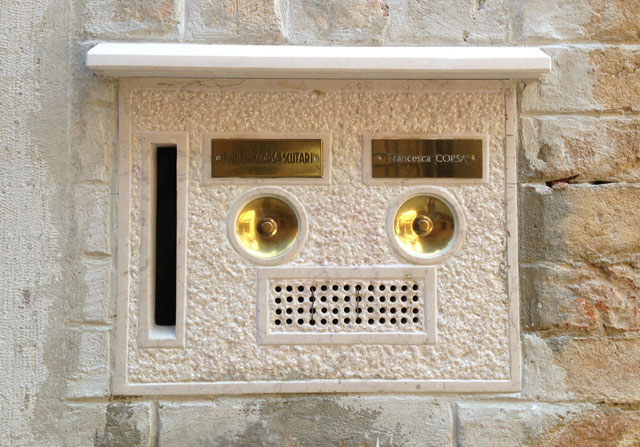 Typical intercom cum letter box, with only one letter box, as usual.