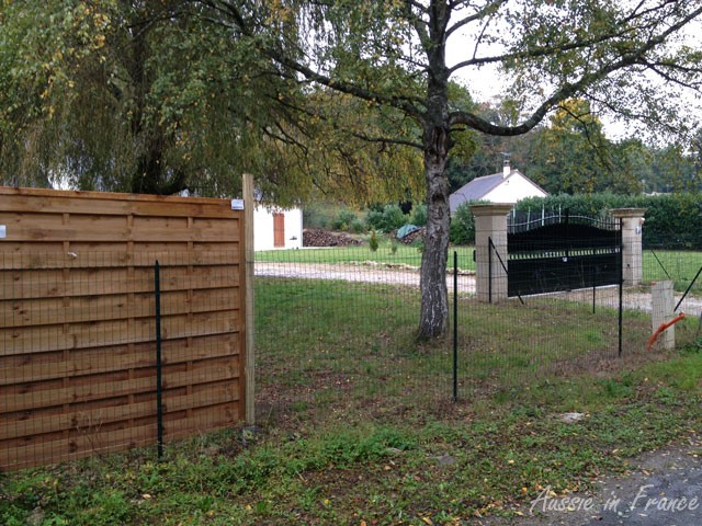 The first two panels erected between our wall and the neighbour's gate