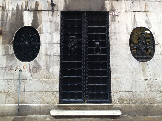 Iron door flanked by medallions