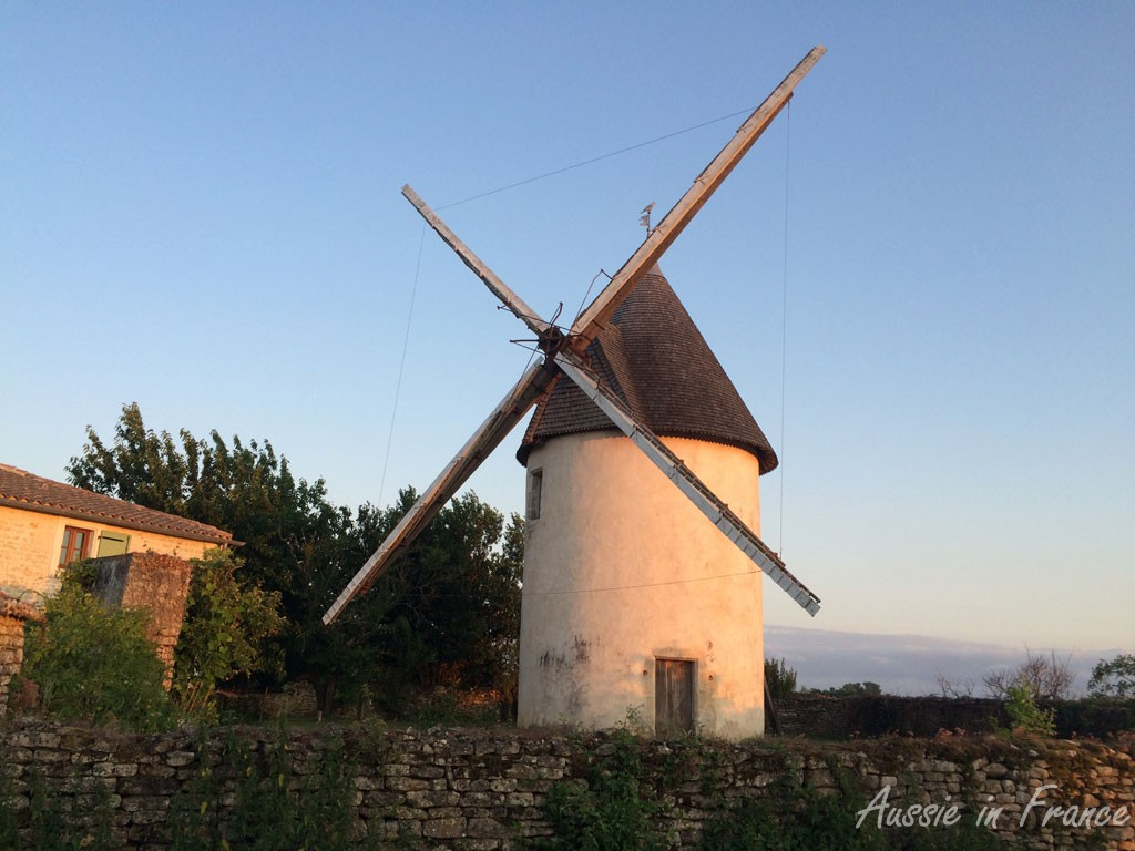 Old windmill at sunset