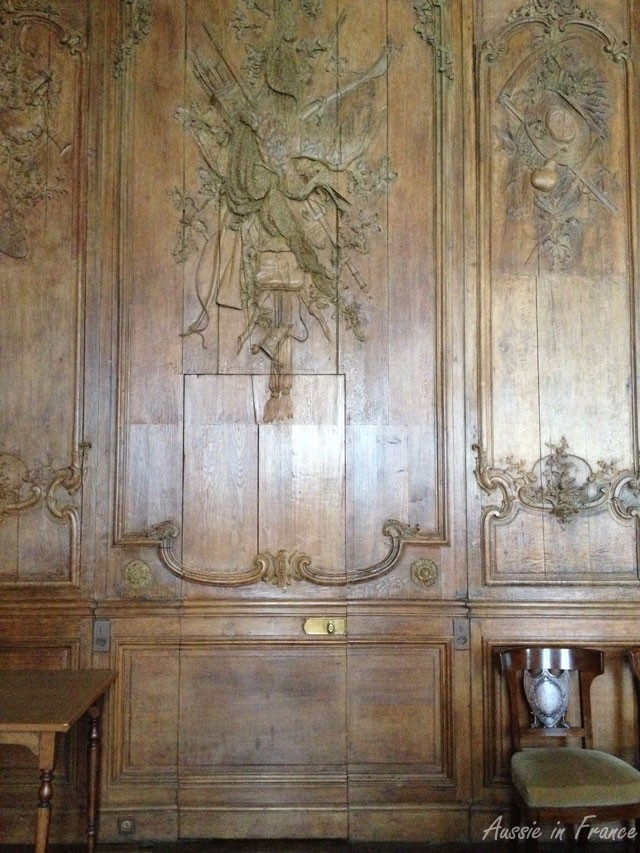 Wood panelling hiding a door into the Gallery